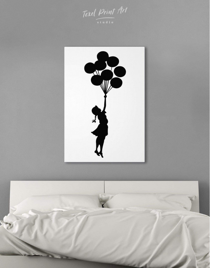 The Girl with the Balloons by Banksy Canvas Wall Art - Image 0