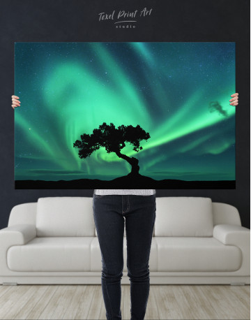 Aurora Borealis and Silhouette of a Tree Canvas Wall Art - image 1
