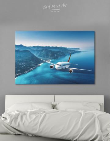 Aeroplane Flying Over Islands Scene Canvas Wall Art